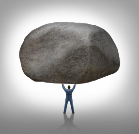 man-holding-rock-strength.jpg